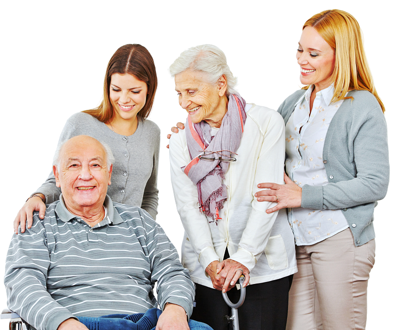 two female caregivers and couple senior are smiling