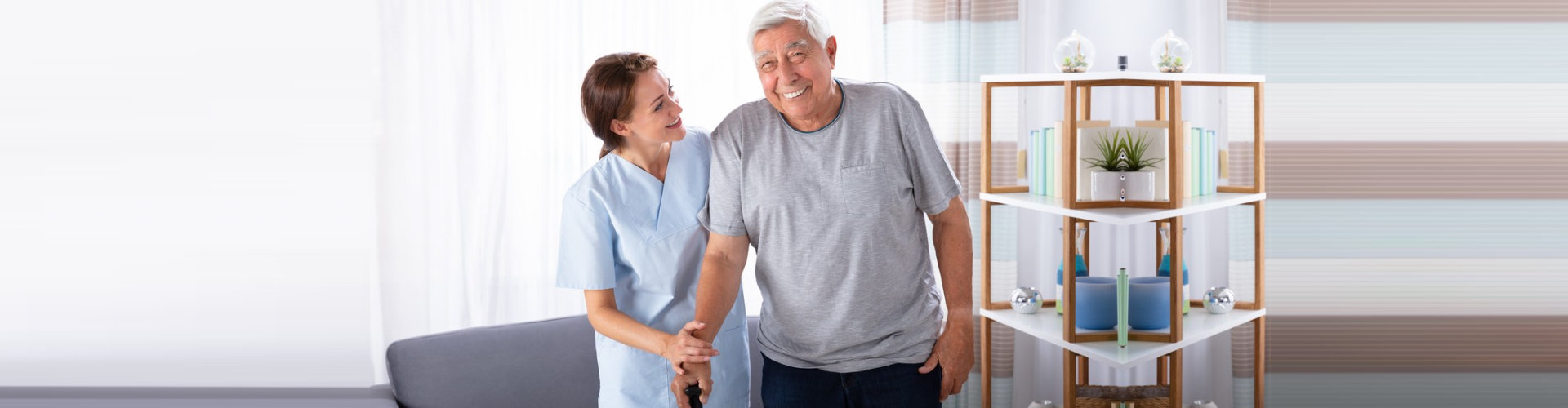 nurse assisting senior man to walk