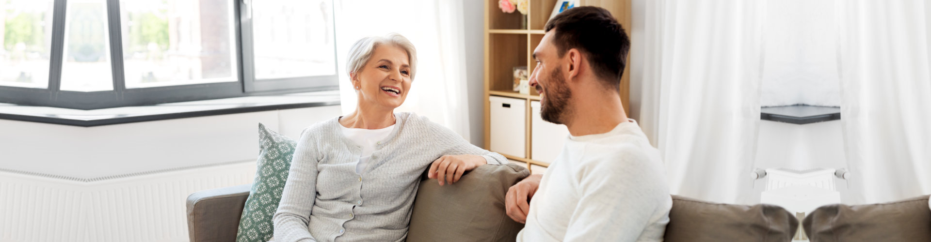 caregiver and senior woman having a conversation